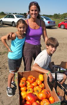 Harvesters with some of their bounty at last Saturday's Tomato U-Pick.